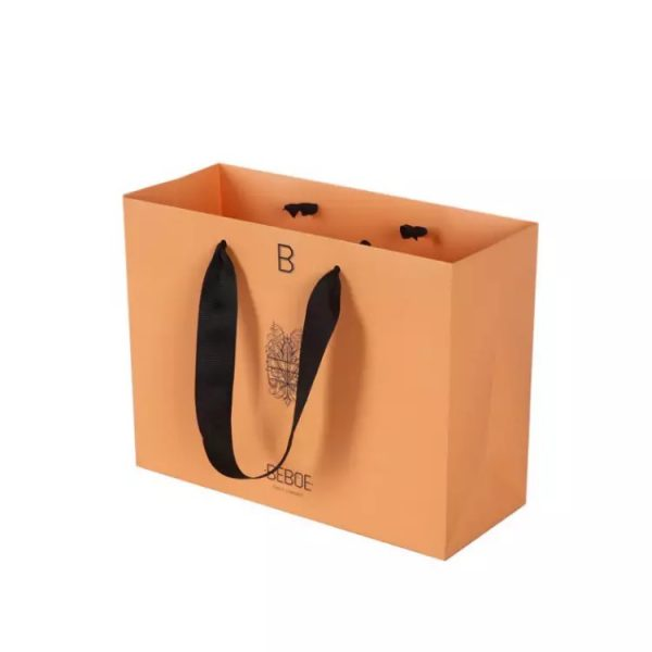 black ribbon handle bag