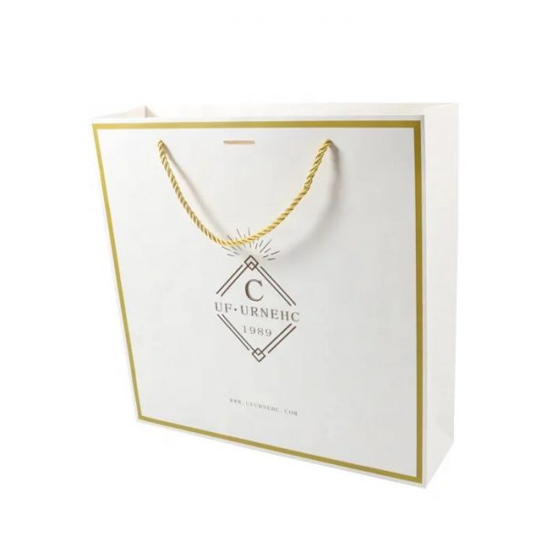 white kraft bag with gold print
