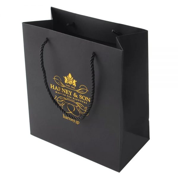 Black carrier bag with gold foil logo